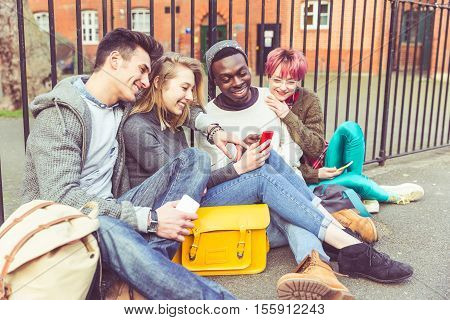 Group Of Young Friends With Smart Phones