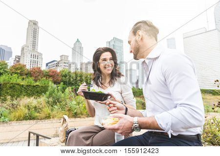 Business People Having Lunch At Park In Chicago