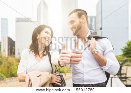 Successful Business Couple Showing Thumbs Up