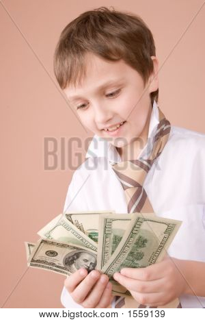 Young Businessman Showing Money