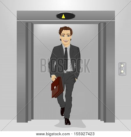 young businessman with briefcase coming out of the office building elevator