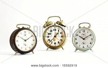Three Old Vintage Alarm Clock Isolated On White