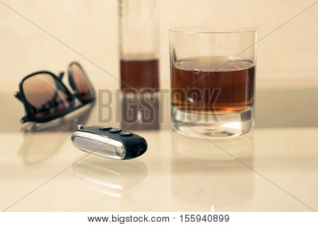Drunk driving - the cause of car accidents. Drink driving. A bottle, a glass and keys.