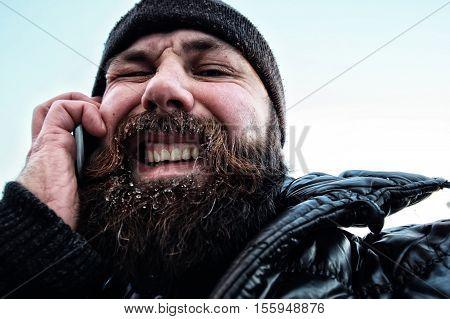 bearded dirty man in a sunny winter macro portrait
