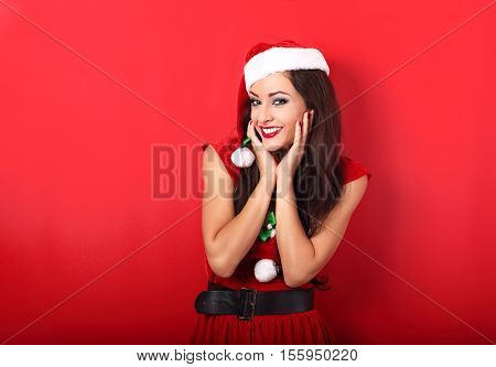 Happy Toothy Smiling Excited Woman In Santa Claus Costume With Bright Makeup And Red Lipstick Posing