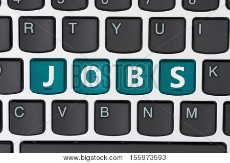 Searching for jobs online A close-up of a keyboard with teal highlighted text Jobs