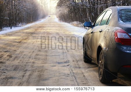 dark elements of car in the winter with hoar frost on them