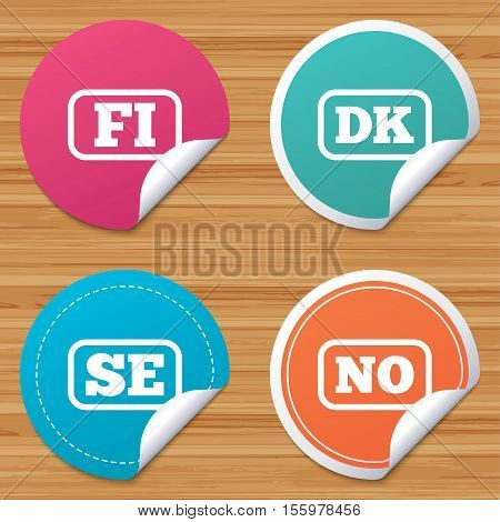 Round stickers or website banners. Language icons. FI, DK, SE and NO translation symbols. Finland, Denmark, Sweden and Norwegian languages. Circle badges with bended corner. Vector