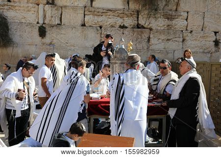 Jerusalem, Israel - November 2 , 2016: Bar Mitzvah Ceremony at the Western Wall in Jerusalem Old City. Bar Mitzvah is the Jewish rite of passage from boyhood to manhood.