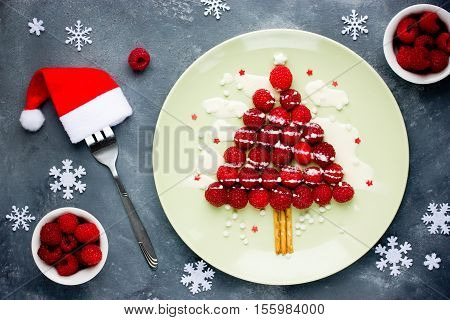 Christmas fun food idea for kids - raspberry Christmas tree for dessert or breakfast
