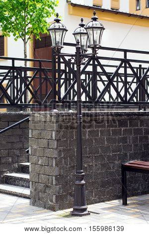 stone stairs in the park with decorative railings and lampposts closeup