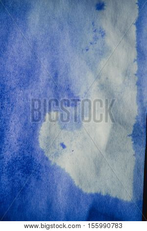 Blue Ink Stain on a Sheet of White Paper Macro. Abstract Background. Spreads Ink Stains with Streaks on a White Background. Absorb Close-up