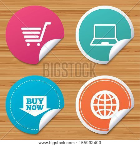 Round stickers or website banners. Online shopping icons. Notebook pc, shopping cart, buy now arrow and internet signs. WWW globe symbol. Circle badges with bended corner. Vector
