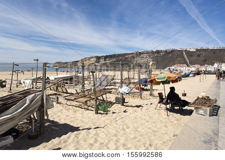 NAZARE, PORTUGAL - September 13, 2016: Drying and selling dried fish on the beach of Nazare Portugal