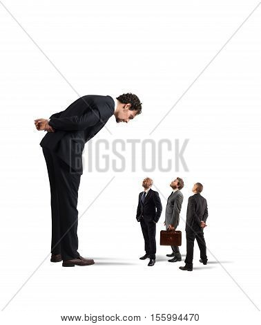 Big businessman looking small businessmen. Severe boss humiliates his employees
