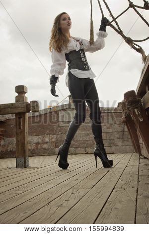 Fashion Portrait Of Woman In Pirate Style At Ship