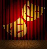 picture of mummer  - against the background of red curtain  - JPG