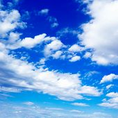 white fluffy clouds in the blue sky poster