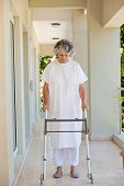 image of zimmer frame  - Senior woman with her zimmer frame - JPG