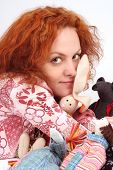 Red-Haired Young Woman With Fluffy Toys poster