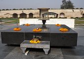 picture of gandhi  - Altar like platform with eternal flame on the spot where Gandhi was cremated - JPG