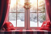 Merry Christmas and Happy Holidays! A beautiful decorated for Christmas window. Winter forest from t poster