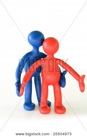 Colored Plasticine Puppets Standing On White Background