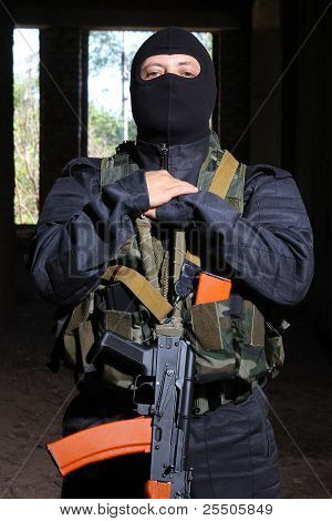 Soldier In Black Mask Holding Ak-47 Gun