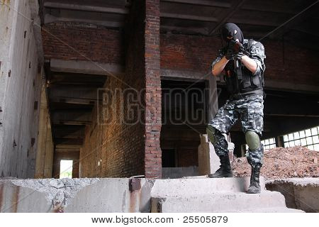 Terrorist In Black Mask Targeting With A Gun