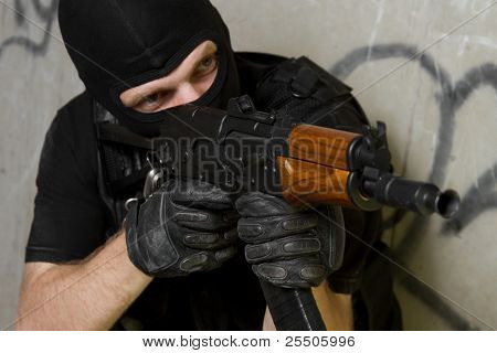 Soldier In Black Mask Targeting With Ak-47 Rifle