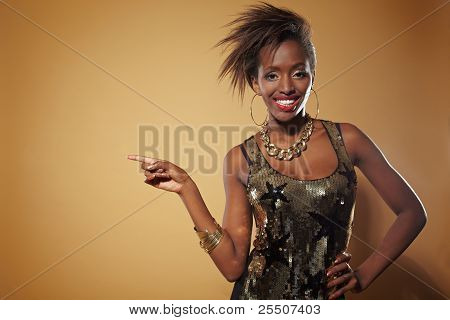 Happy African Woman Pointing With Finger