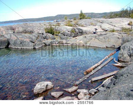 Shallow Pond With Rocks