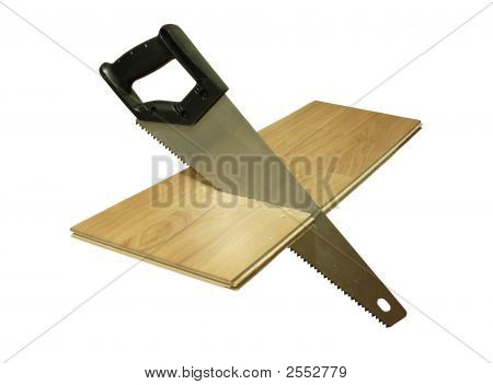 Hacksaw And Wooden Plate