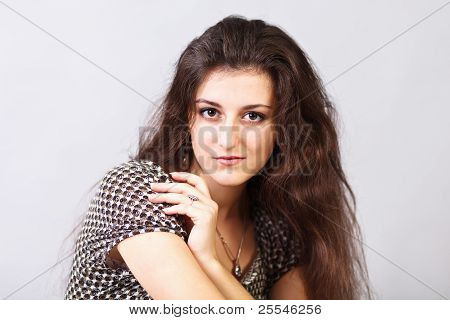 Brunette Girl`s Portret Isolated On Gray Background.
