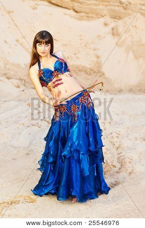 Belly Dancer In Blue Lingerie With Gold Cane.