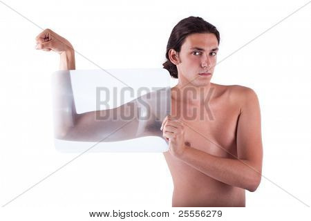 Slender young man flexing with no shirt isolated on a white background.