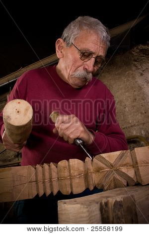 Old woodcarver work in the workshop 6