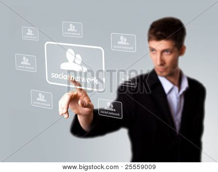 Businessman hand pressing Social network sign . selective focus