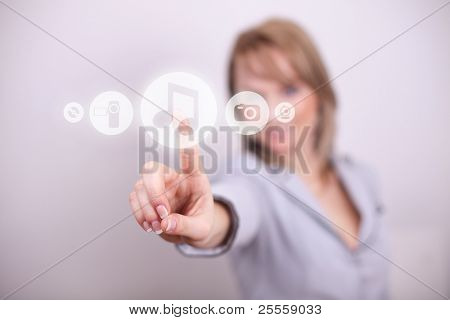 Woman pressing music and media button with one hand