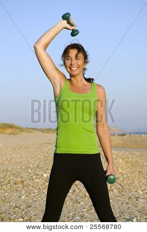 A happy woman exercising.