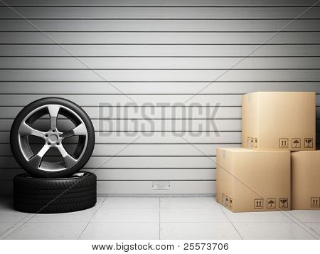 Garage with car spare parts on background of roll up door