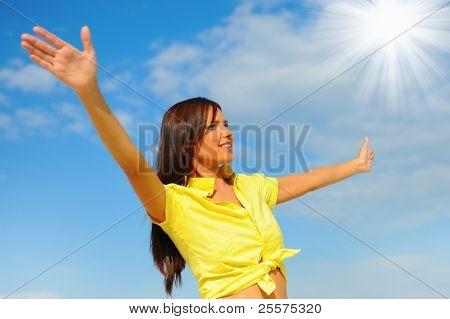 Beautiful Woman over blue Sky