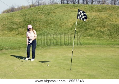 Lady Putting On Golf Course
