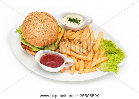 Hamburger with fries and sauces on plate
