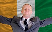 Happy Businessman Because Of Profitable Investment In Cote'd Ivore Standing Near Flag