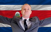 Happy Businessman Because Of Profitable Investment In Costarica Standing Near Flag