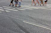 People Crossing City Street On Pedestrian Zebra With Empty Asphalt Road Background. Pedestrian Cross poster