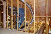 Home Construction With Installation Of Heating System On The Roof Of The Pipe System Of Heating Clos poster