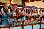 Постер, плакат: Stand With Sweets In Christmas Market At Kaiser Wilhelm Memorial Church In Winter Berlin Germany A