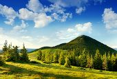 image of sate  - Summer landscape in mountains and the dark blue sky with clouds - JPG